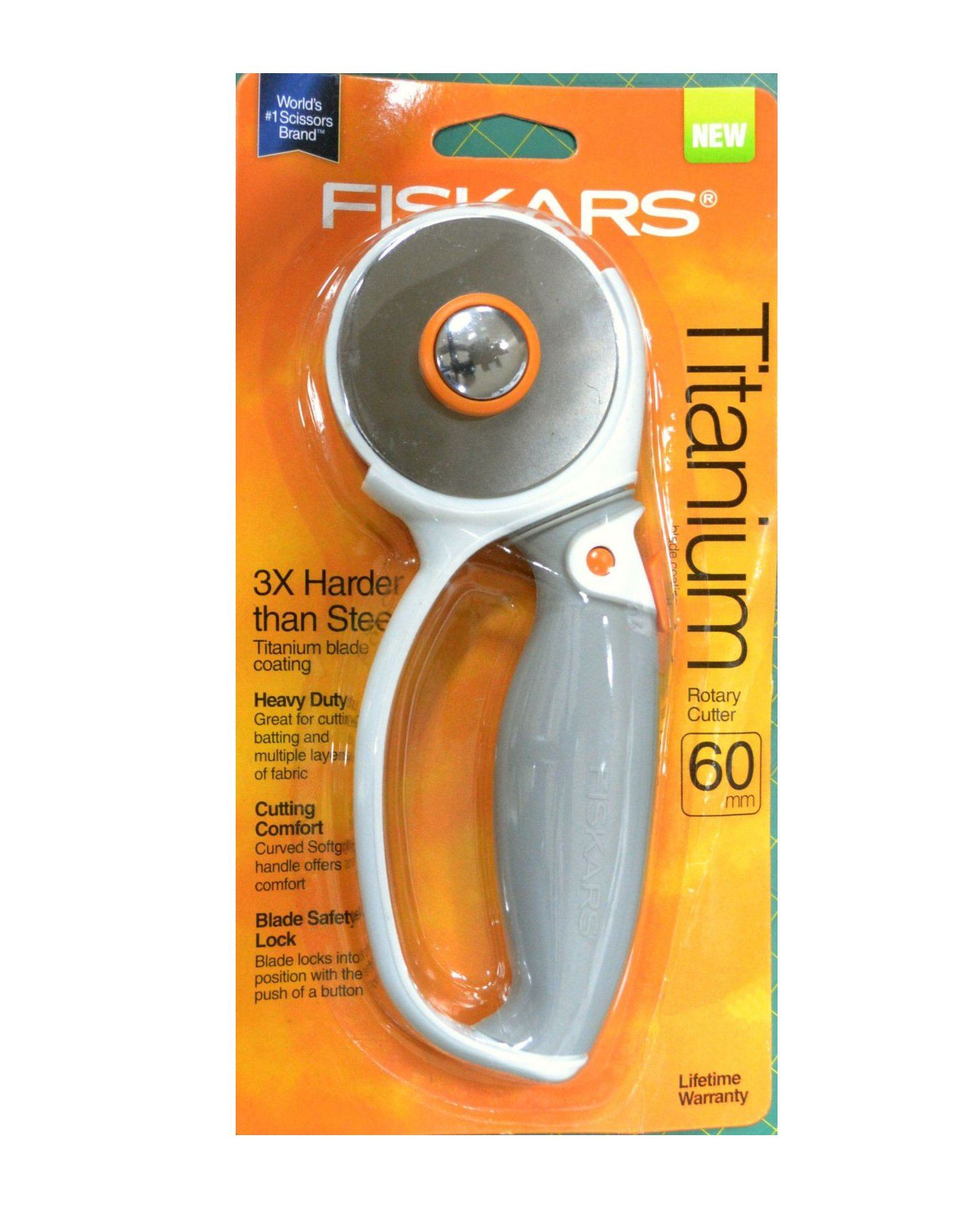 FISKARS 60mm Rotary Cutter, TITANIUM BLADE, with Soft Grip Loop & Safety Blade Lock. Titanium Blade Coating - 3X harder than steel All-Purpose cutting Curved soft grip handle for comfort Blade safety lock